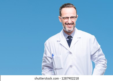 Middle age senior hoary professional man wearing white coat over isolated background winking looking at the camera with sexy expression, cheerful and happy face.