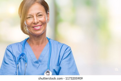 Middle age senior nurse doctor woman over isolated background happy face smiling with crossed arms looking at the camera. Positive person.