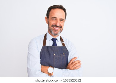 Middle age shopkeeper man wearing apron standing over isolated white background happy face smiling with crossed arms looking at the camera. Positive person.