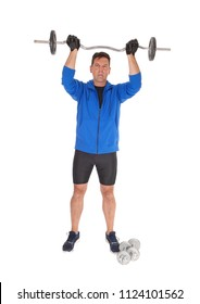 A middle age tall man standing from the front and lifting the weight