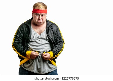 Middle age upset stressed fatty man with big belly unable to zip clothes due to gaining weight.