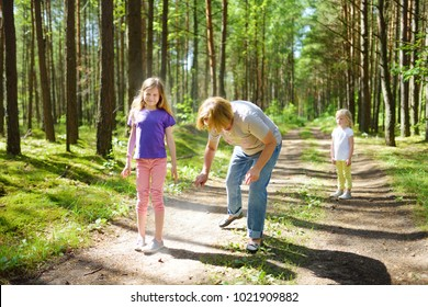 Middle age woman applying insect repellent to her granddaughter before forest hike beautiful summer day. Protecting children from biting insects at summer. Active leisure with kids.
