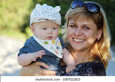 middle age woman with a baby in her hands