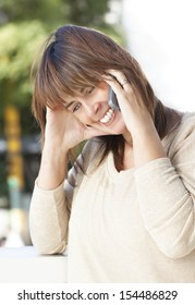 middle age woman cheerful and using her cellular phone