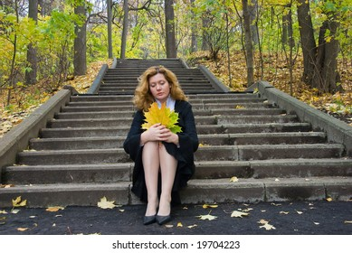 Middle age woman in depression on an autumn nature