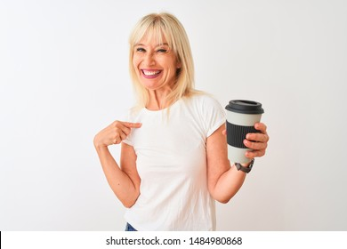 Middle age woman drinking glass of take away coffee standing over isolated white background with surprise face pointing finger to himself