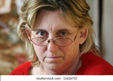 Middle Age Woman Looking Over Her Glasses