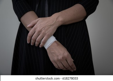 Middle age woman showing the scars of self harm.