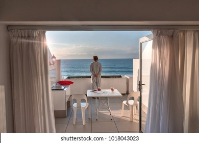 Middle age woman standing on the terrace view of the Pacific ocean, Durban