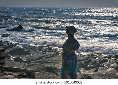 Middle age woman standing on the shore of the Pacific Ocean, Durban