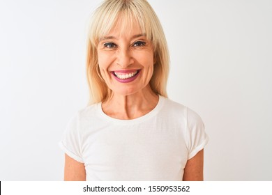 Middle age woman wearing casual t-shirt standing over isolated white background with a happy face standing and smiling with a confident smile showing teeth