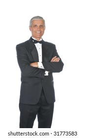 Middle Aged  Adult Male Wearing a Tuxedo with arms folded in front of body isolated on white