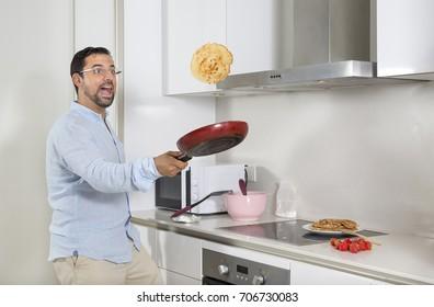 middle aged arab man flipping a pancake