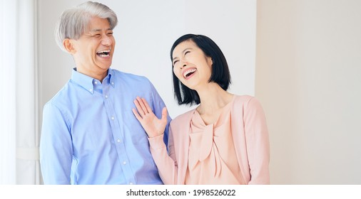 Middle aged asian couple in the house. Senior lifestyle concept.