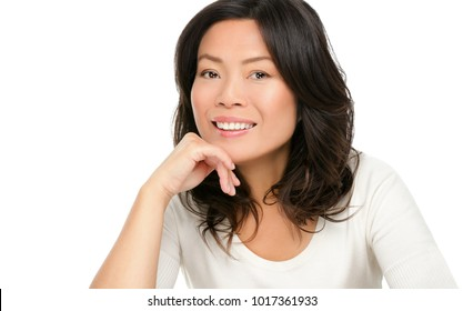 Middle aged Asian mature woman smiling happy studio portrait isolated on white background. Beautiful mature middle aged Chinese Asian woman beauty for skincare, anti-aging treatment concept.