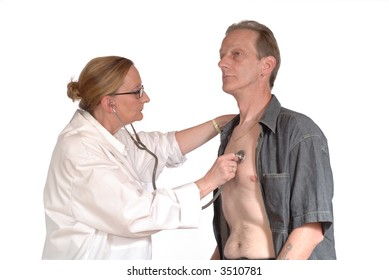 Middle aged attractive female doctor giving physical exam to male patient.  health care concept.