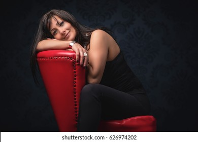 Middle aged beautiful woman in elegant room