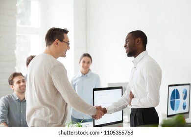 Middle aged boss shaking hand of proud employee congratulating with high work results, job promotion, greeting, CEO praising worker, motivating with handshake. Concept of rewarding, human resources