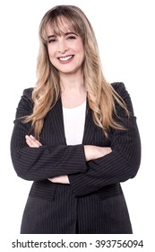 Middle aged business woman posing with arms crossed