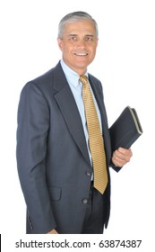Middle aged businessman holding notebook in one hand. Man is standing and smiling. Vertical format isolated on white.