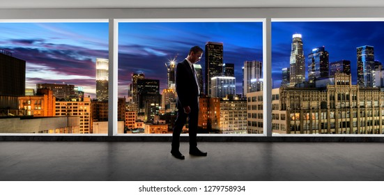 Middle aged businessman looking out a bright office window and thinking in city of LA