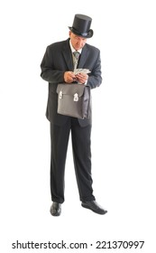 Middle aged  businessman in a retro business suit with money isolated on white.