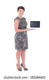 middle aged businesswoman showing laptop with blank display isolated on white background