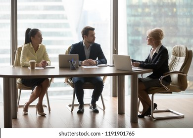 Middle aged businesswoman talk on business meeting in office with company partners, female boss discuss contract at negotiation with colleagues, director briefing in boardroom. Partnership concept