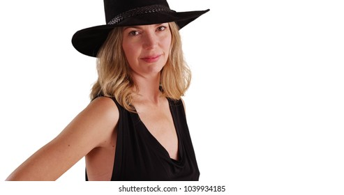 Middle aged Caucasian woman in black hat smiling at camera