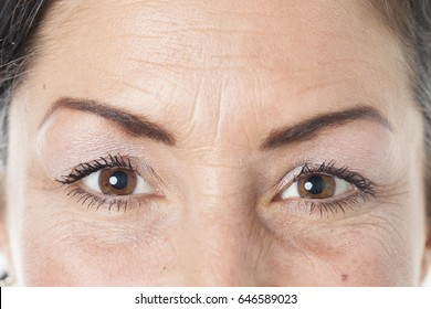 Middle aged caucasian women eyes closeup; isolated on white background