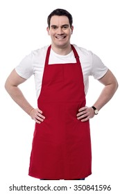 Middle aged chef posing happily against white