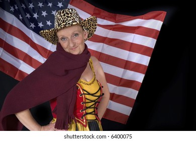 Middle aged country and western woman with traditional dress in front of american flag. Big smile on face. Dark background