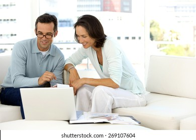 Middle aged couple doing home finances
