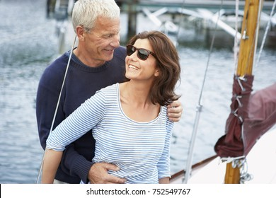 Middle aged couple on an old boat