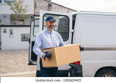 middle aged courier delivering a packages