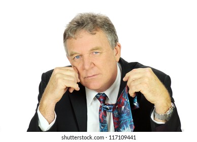 Middle aged depressed businessman looking frustrated holding his tie.