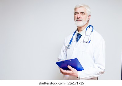 middle aged doctor male men gray beard and hair empty background