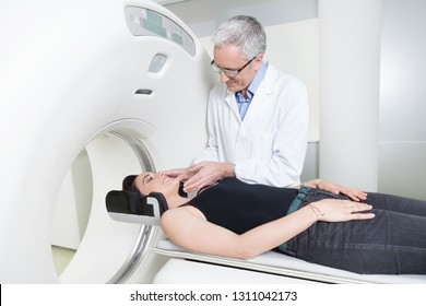 middle aged doctor in white coat explaining the benefits to a woman patient the magnetic resonance imaging machine MRI and computed tomography at hospital.