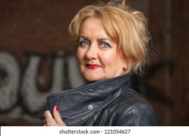 Middle aged good looking woman. Urban fashion.