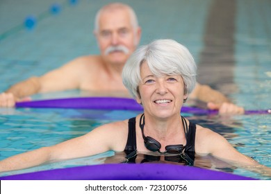 middle aged happy couple in swimming pool