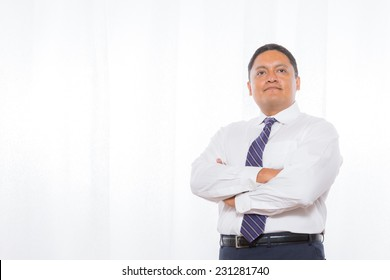 Middle aged hispanic male in suit with confident expressions