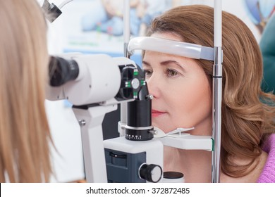 Middle aged lady is visiting oculist in clinic