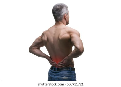 Middle aged man with back pain, muscular male body, studio isolated shot on white background with red dot