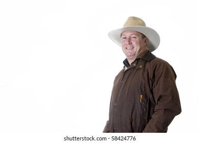 89845c63b8991 middle aged man in cowboy hat and oilskin coat