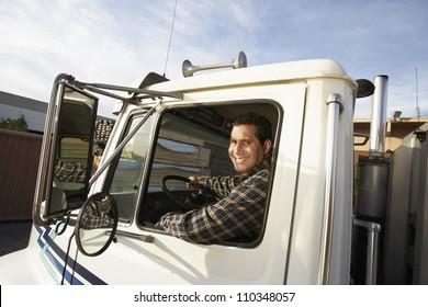 Middle aged man driving truck