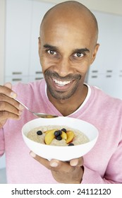 Middle Aged Man Eating Healthy Breakfast