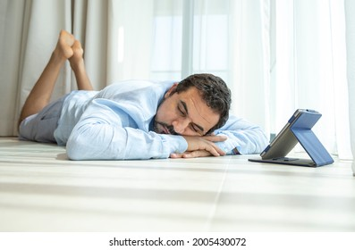 middle aged man fallen asleep while reading a book in his e-reader