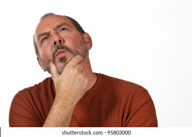 middle aged man with hand on beard looking up thinking
