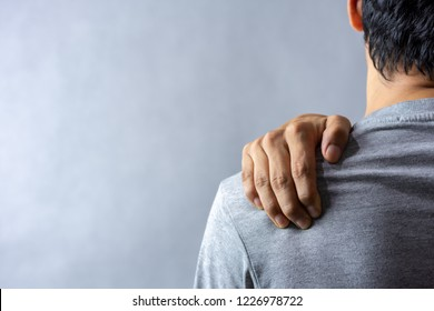 Middle aged man has shoulder pain. with copy space for text
