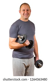 Middle aged man in his forites lifting exercise weights.